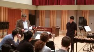 "he score to ""Burritt Variations"" by Alejandro Vinao, as Eastman senior, Sam Um  prepares to perform on marimba."
