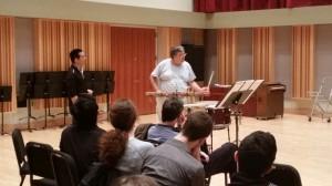 "Zoltan Rácz demonstrates a point in ""Rebonds b"" by Iannis Xenakis to Eastman grad student, Darren Lin (standing left)"