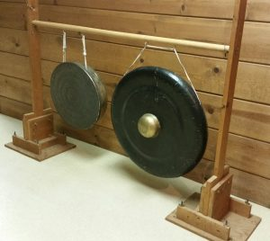 Photo 9 - Gongs suspended from screw hooks on a home-made wooden rack