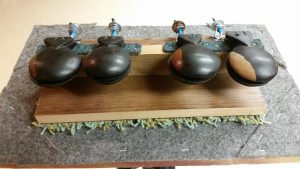 The four pair of high-sounding castanets on this double machine are Spanish. They were recently purchased in a local antique shop.
