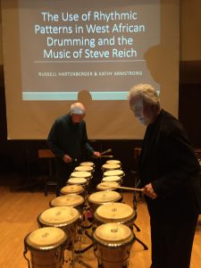 Bob Becker and Garry Kvistad tuning the bongos for a sixteen drum performance of Steve Reich's Drumming, Part I at the University of Toronto, Dec. 1, 2016. Photo: Russell Hartenberger.