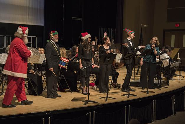 """Soloists in Haydn's Toy Symphony (Garry is the """"Little"""" Drummer Boy) with Maestra Kathleen Beckmann - Photo by Guy Peifer"""